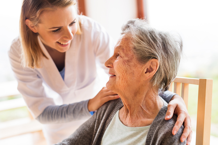 Healthcare staff personal taking care a resident