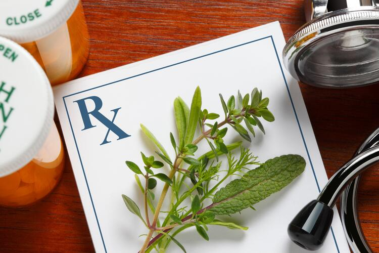 Herbs and prescriptions representing the difference Between Alternative and Complimentary Approaches in holistic healthcare