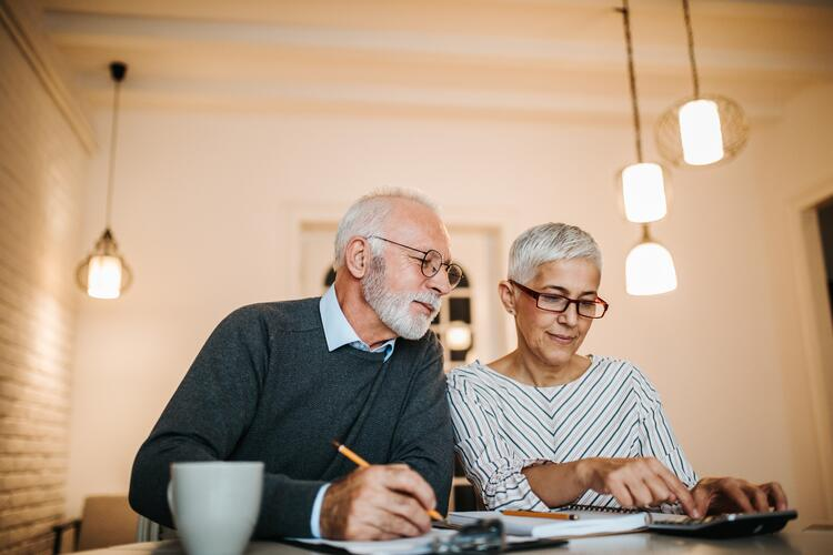 senior couple going over legal documents for loved one with long term memory loss