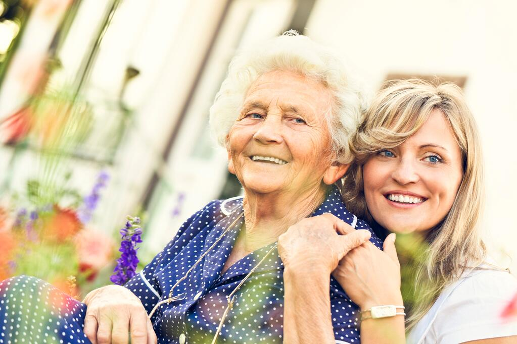 Senior parent and adult child with questions about assisted living costs
