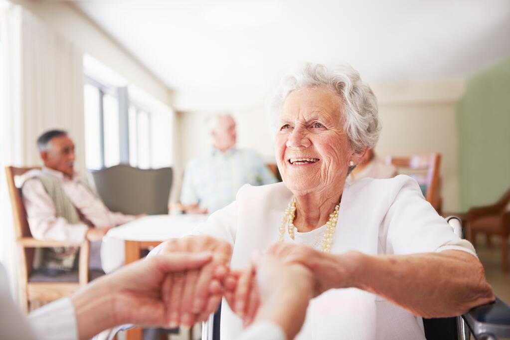 Senior woman in assisted living community working with an individual who is advocating for holistic health care