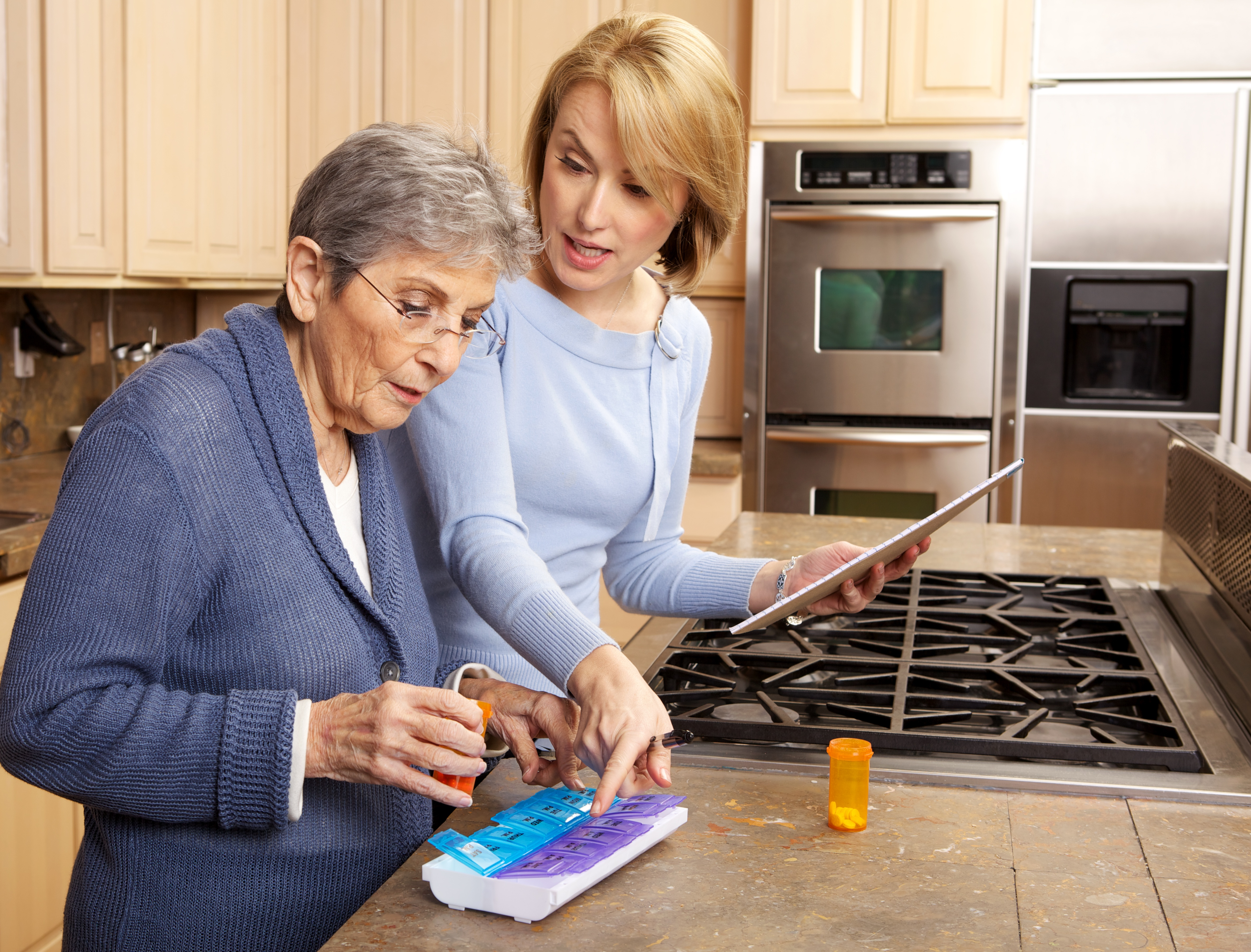 Family caregiver managing medications for a parent with dementia