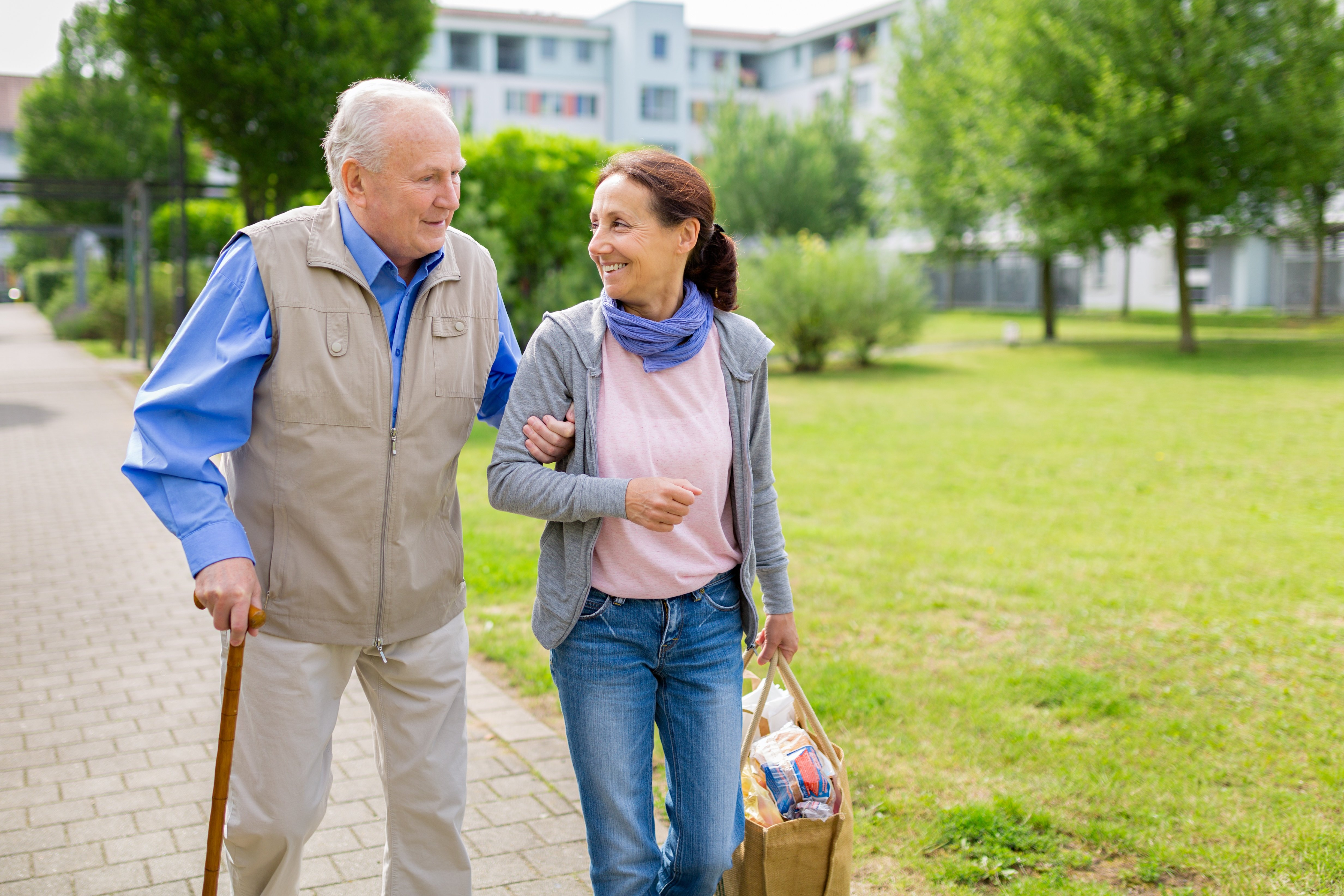 older adult couple going for a walk to decrease falls and improve mobility