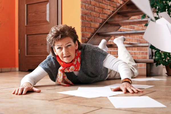 Senior woman slipped and fell down the stairs in her home