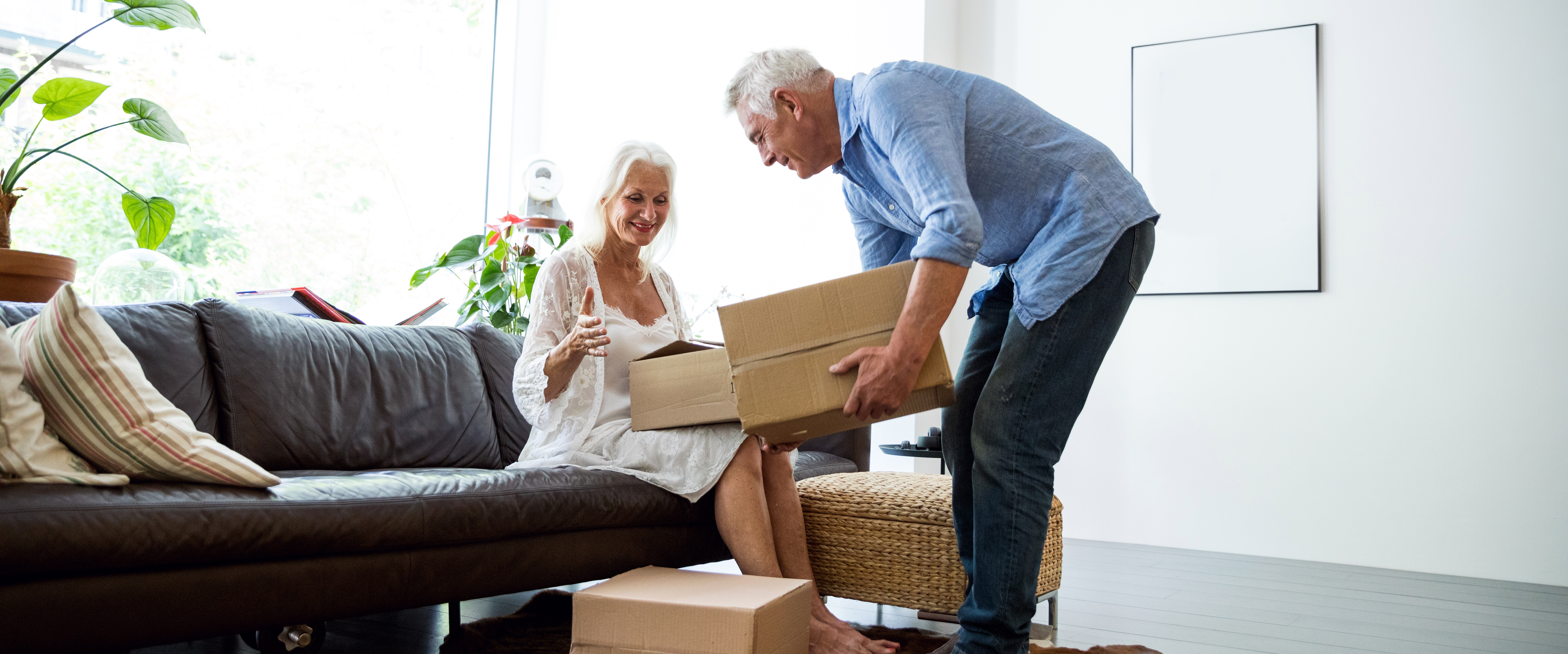 Couple going through boxes of their stuff together