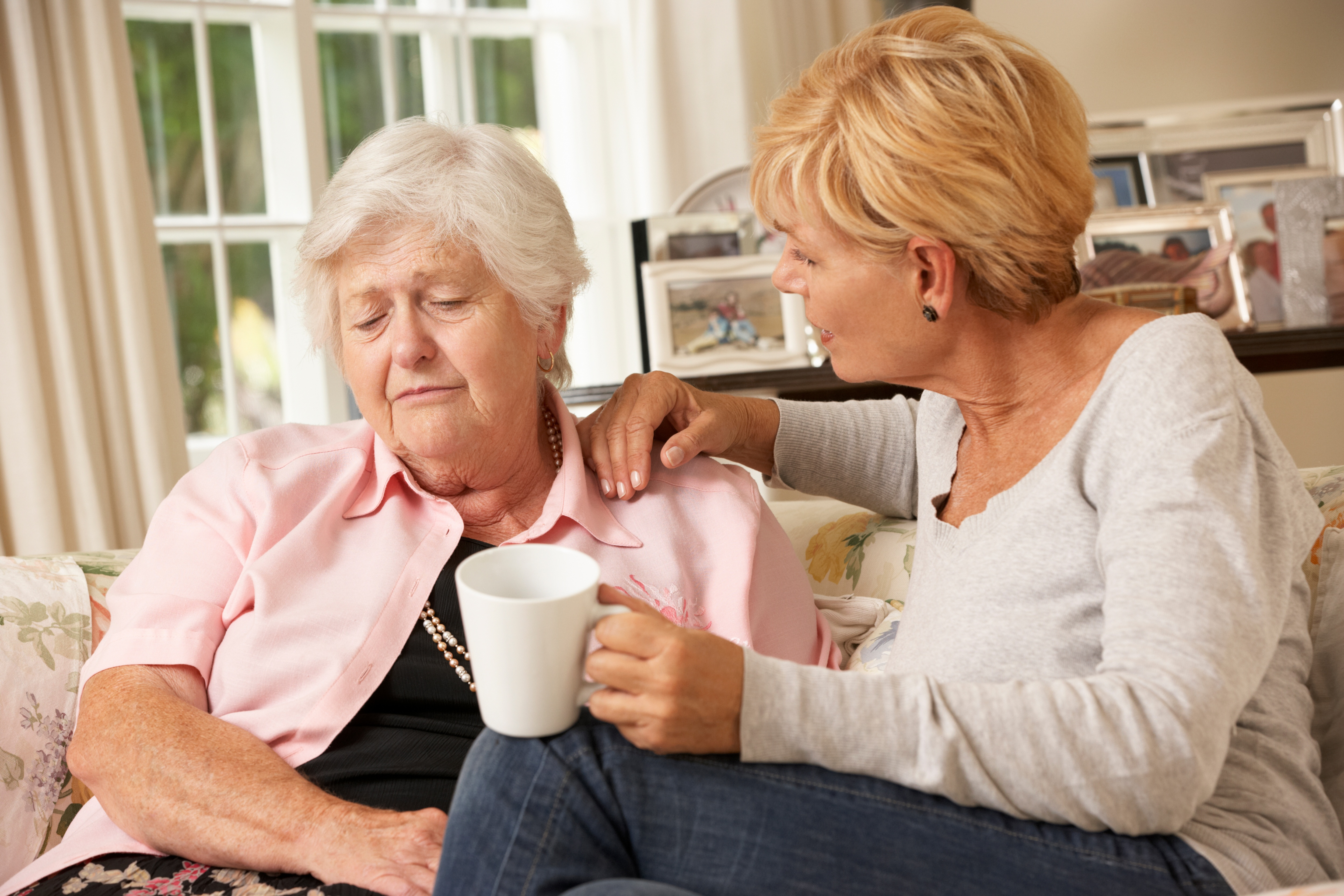 Adult child having the talk about assisted living with her senior parent after recognizing the signs it was time
