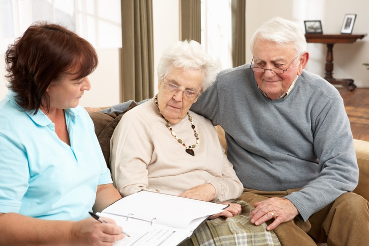 couple discussing with a care advisor assisted living costs