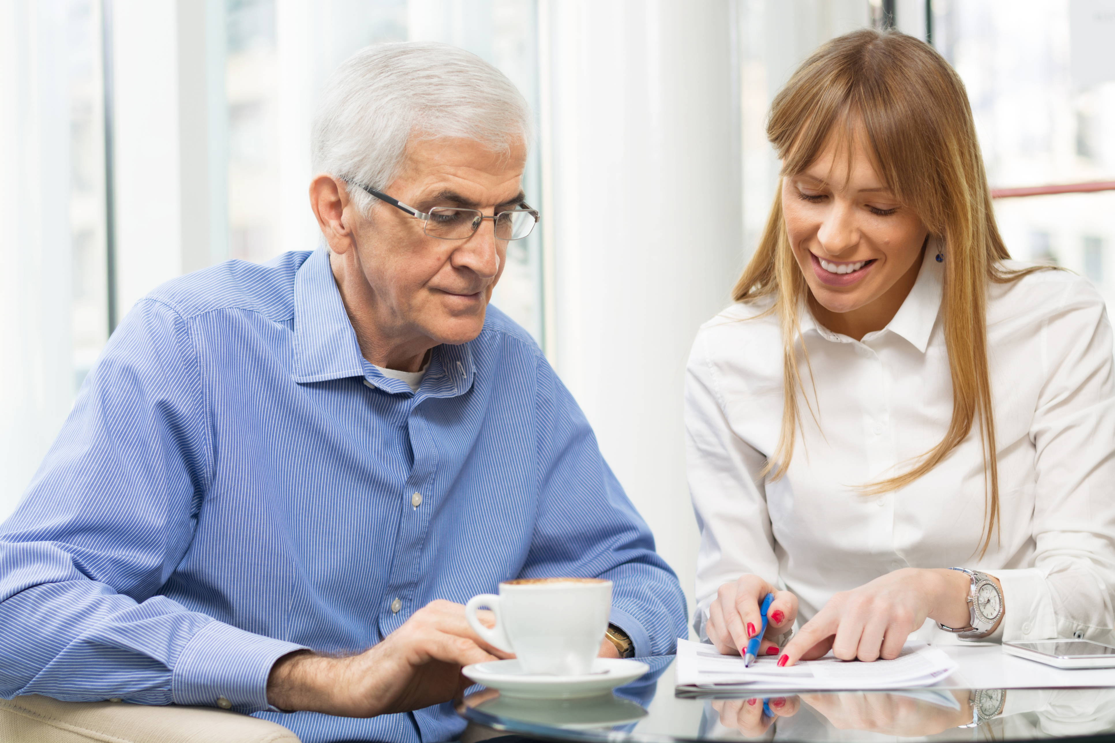 health professional helping an elderly man go through paperwork