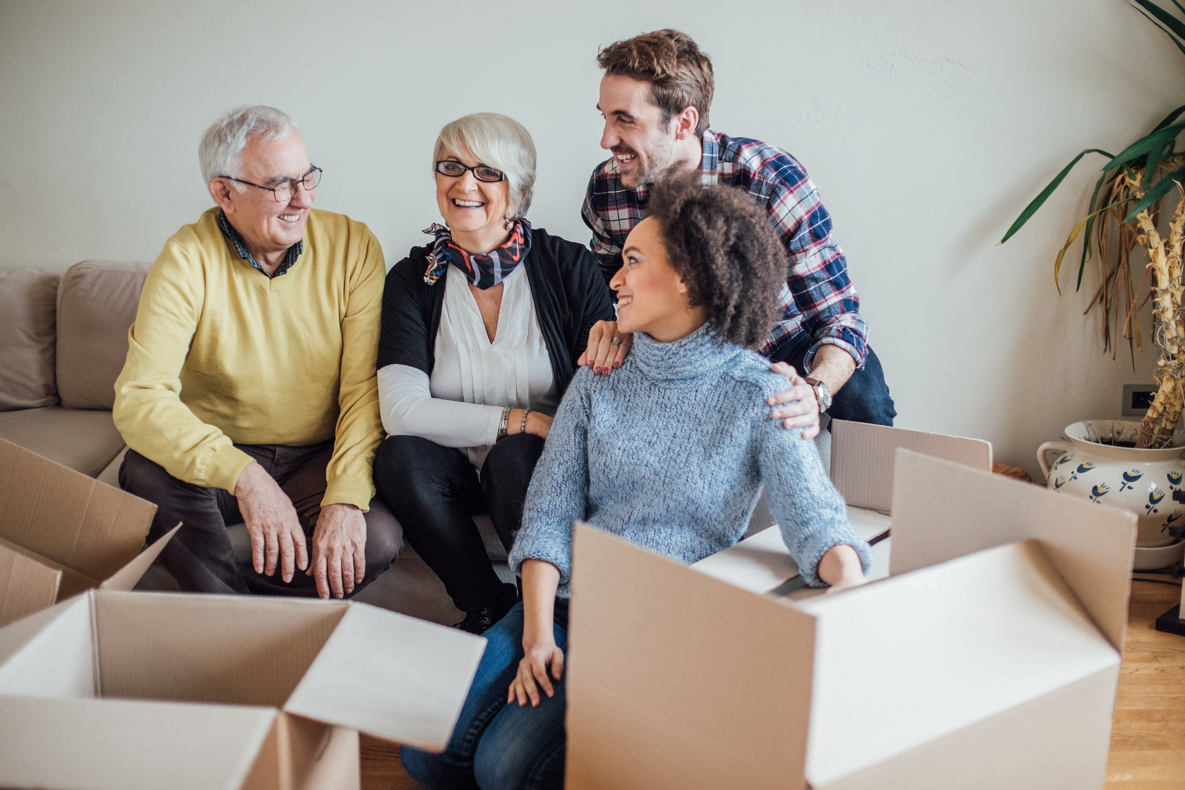 Family packing boxes together while laughing with one another