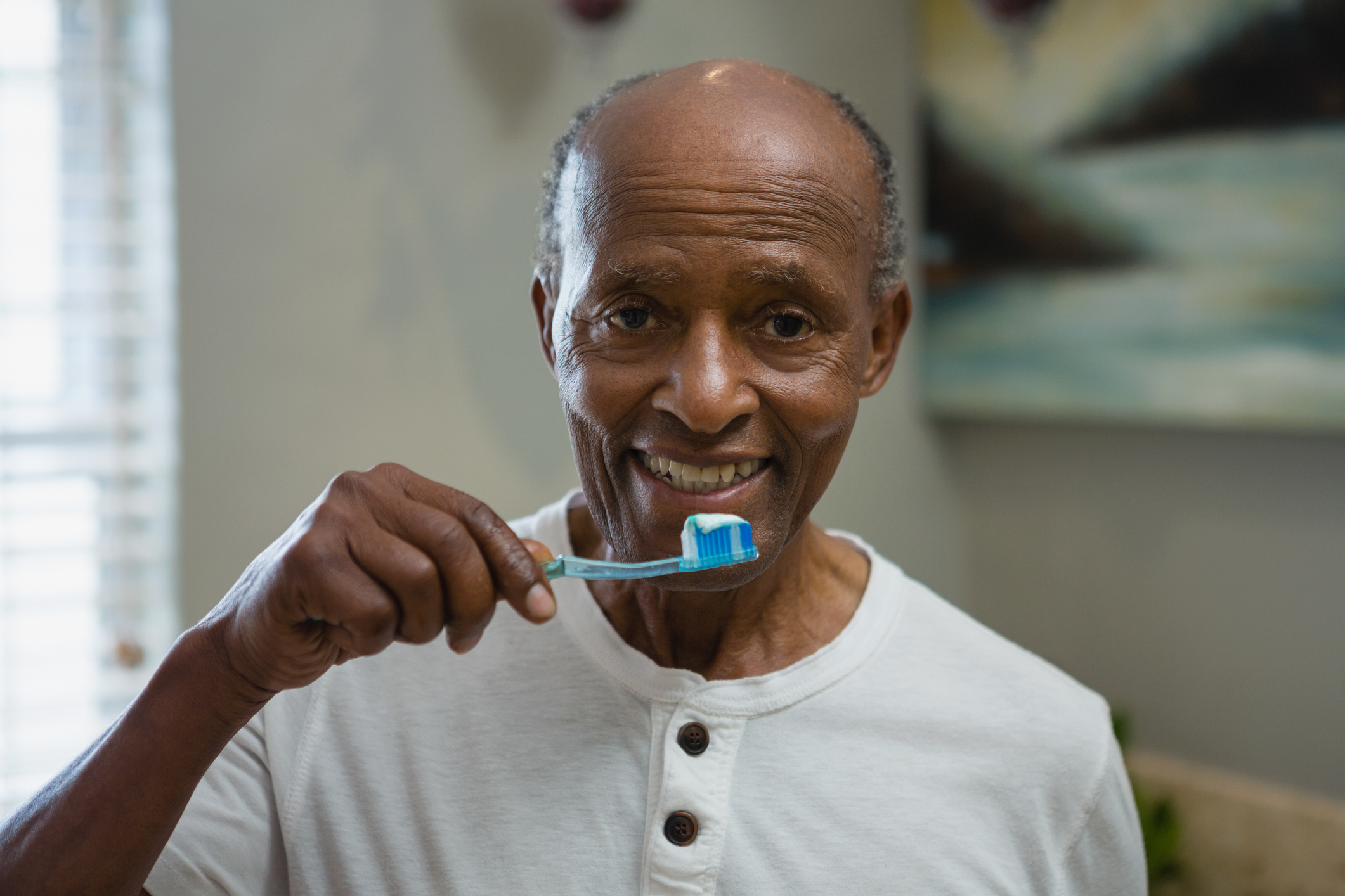 A man brushing his teeth getting ready for the day